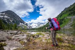 Hiker is climbing rocky slope of mountain in Altai mountains, Ru. Ssia Royalty Free Stock Photos