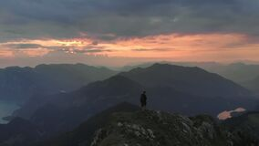 Hiker climbing Schafberg mountain at sunrise in Austria