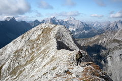 Hiker is climbing up Royalty Free Stock Image