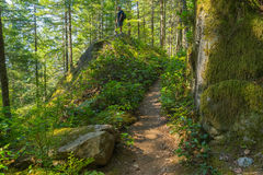 Hiker Climbs Granite Boulders Stock Images