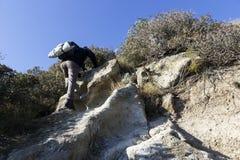 Hiker climbs Stock Image
