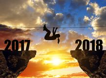 Hiker climbs into the New Year 2018. Royalty Free Stock Image