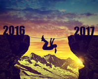 Hiker climbs into the New Year 2017 Stock Images
