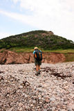 Hiker on Cobblestone Beach Royalty Free Stock Photo