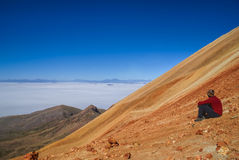 Hiker on colored mountain Stock Photography
