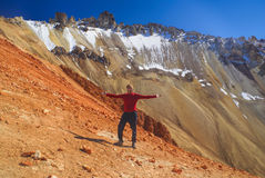 Hiker on colored mountain Royalty Free Stock Image
