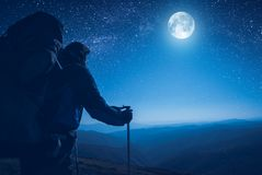 A hiker contemplate the full moon Stock Photo