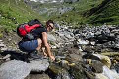 Hiker cools a stream Stock Image