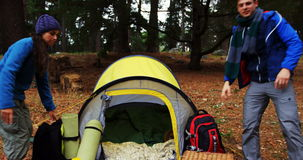 Hiker couple arriving. At camp stock video footage