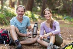 Hiker couple having coffee Stock Photo