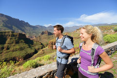 Hiker couple hiking on Gran Canaria. Romantic hikers enjoying hike in beautiful mountain forest landscape. Blonde women hiker and Caucasian men on Gran Canaria stock photos