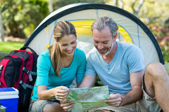 Hiker couple looking at map Royalty Free Stock Photo
