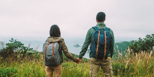 Hiker couple in love enjoying view of sea Royalty Free Stock Image