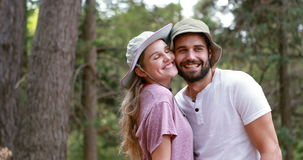 Hiker couple romancing at countryside. In forest, 4k stock footage