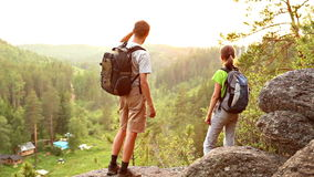 Hiker couple at sunset in beautiful landscape. Hiking people - hiker couple at sunset in beautiful landscape. Hikers man and woman trekking walking with stock video