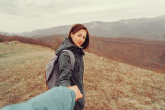Hiker couple walking in mountains Royalty Free Stock Photos