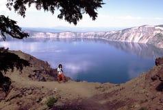 Hiker at Crater Lake stock image