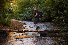 Hiker Crosses Stream Royalty Free Stock Images