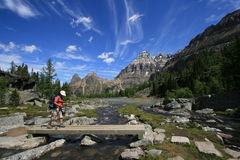 Hiker Crossing Creek in Yoho National Park Royalty Free Stock Images