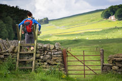 Hiker crossing a Stile Stock Photos