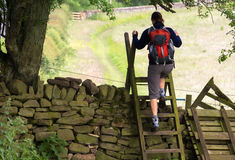 Hiker crossing a Stile Royalty Free Stock Images