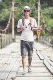 Hiker is crossing wooden bridge in Georgia. Hiker hipster is crossing wooden bridge in Georgia Stock Image