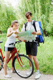 Hiker and cyclist. Traveler asks for directions from a cyclist Royalty Free Stock Photography
