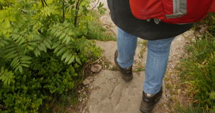 Hiker descending on mountain trail path and walking securely stock video footage