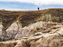 Hiker in Distance at the Top of a Hill Stock Image