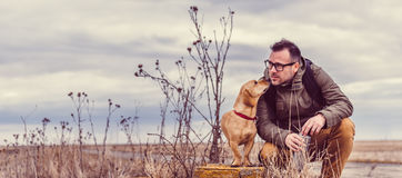 Hiker and dog resting Royalty Free Stock Photo