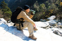 Hiker drinking a water Stock Photography