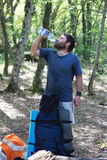 Hiker drinking water in forest Stock Photography