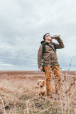 Hiker drinking water Stock Photography