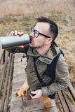 Hiker drinking water Stock Images