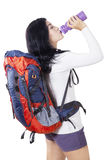 Hiker drinks water with bottle Stock Image