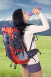 Hiker drinks water at mountain Stock Photos