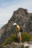 Hiker on edge of mountain Royalty Free Stock Images