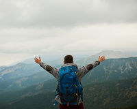 Hiker Embracing The View From Atop A Mountain Stock Image
