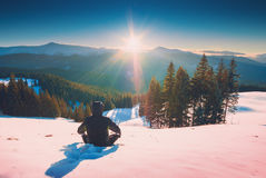 Hiker enjoy majestic winter sunset Royalty Free Stock Image