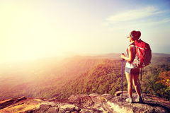 Hiker enjoy the view at sunset mountain peak Stock Photography