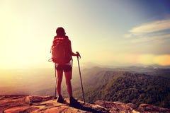 Hiker enjoy the view at sunset mountain peak Stock Photos