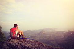 Hiker enjoy the view at sunset mountain peak Royalty Free Stock Photography