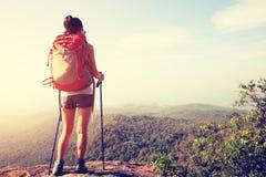 Hiker enjoy the view at sunset mountain peak Royalty Free Stock Photos