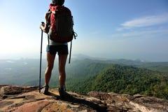 Hiker enjoy the view at sunset mountain peak Royalty Free Stock Image