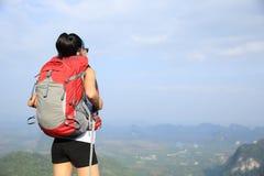 Hiker enjoy the view at sunset mountain peak Stock Image