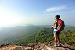 Hiker enjoy the view at sunset mountain peak. Woman hiker enjoy the view at sunset mountain peak Royalty Free Stock Photos