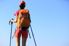 Hiker enjoy the view under blue sky Stock Photography