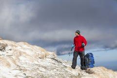 Hiker enjoying beautiful landscape Royalty Free Stock Image