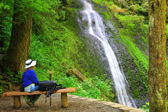 Hiker enjoying the moment of the Waterfalls Stock Photography