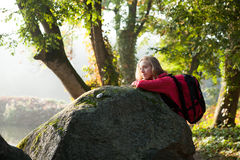 Hiker enjoying relaxation in rocks on the nature Royalty Free Stock Photo